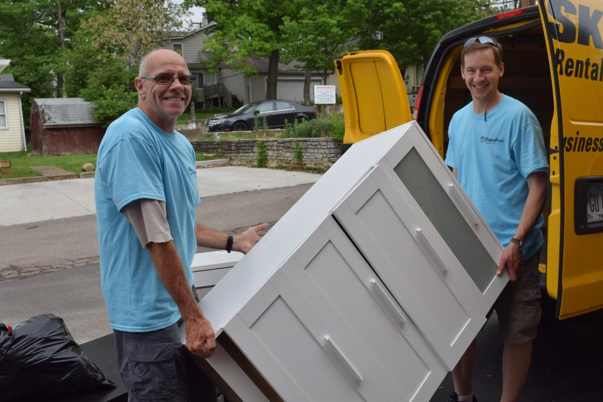 ShareFest 2015 volunteers holding a dresser
